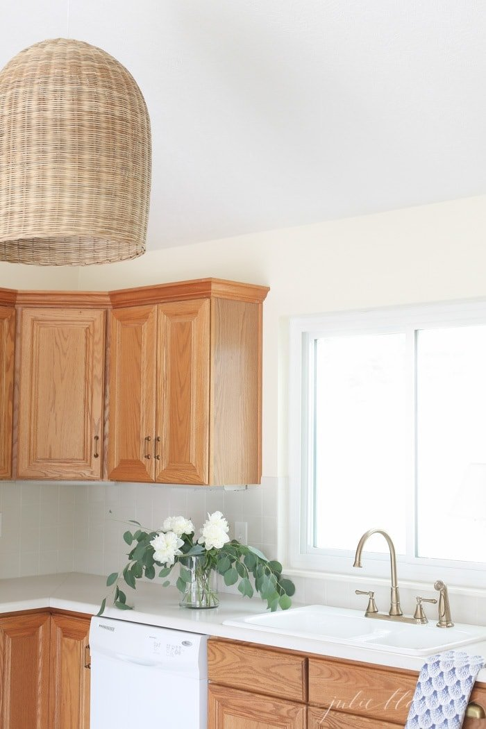 oak overlay cabinets in kitchen with pendant light