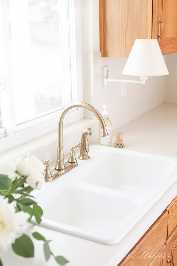 replacing a faucet is an easy and inexpensive way to update a kitchen on a budget