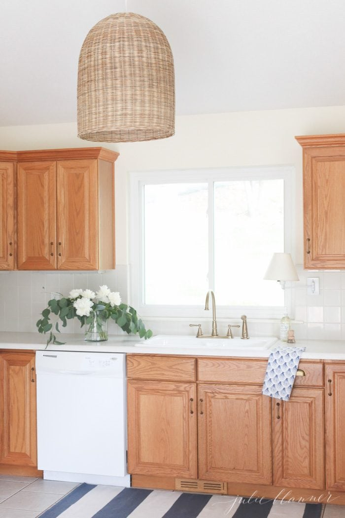 Tips and tricks to update dated oak kitchen cabinets without painting them. Make your oak cabinets feel modern and fresh with these easy diy ideas.