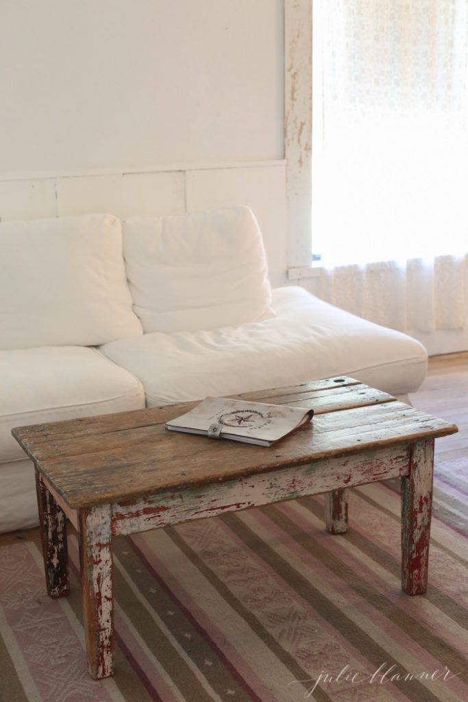 white slipcovered sofa with reclaimed wood coffee table