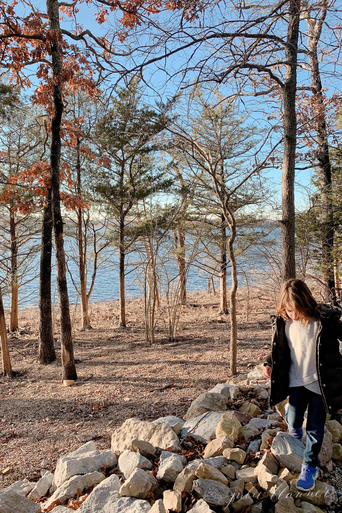 A little girl hiking near water as part of a list of branson mo things to do