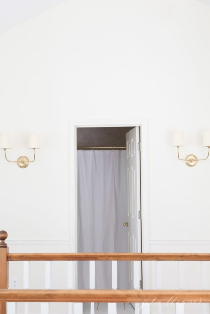 brass sconces, cream paint for a fresh, summer home