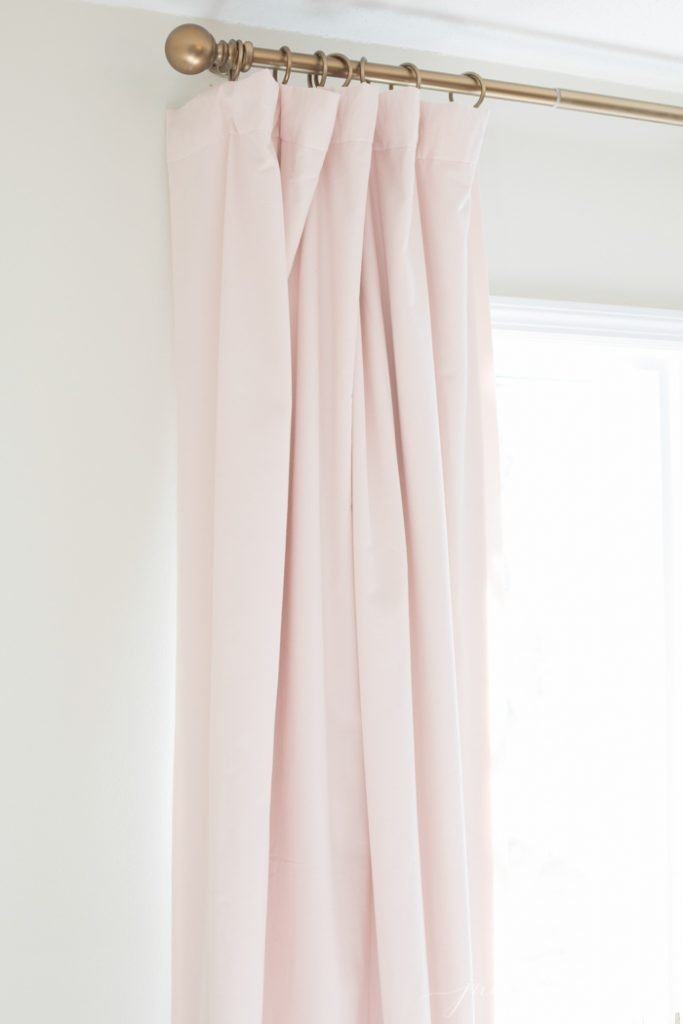 How to hang curtains to make them look like custom drapes for Pull up curtains how to make