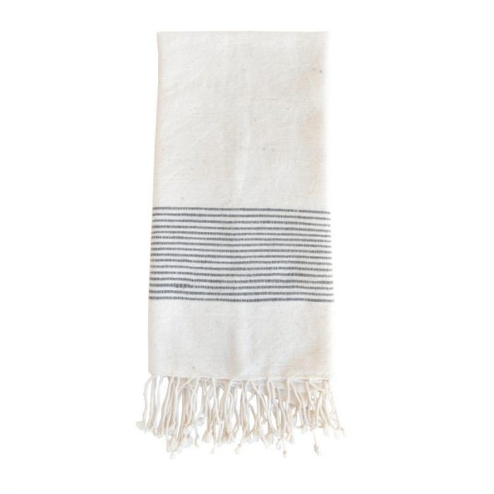 A white fringed hand towel with blue stripes on a white background.