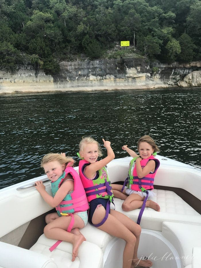 Three little girls on a white boat on Table Rock Lake as part of a list of things to do in Branson Missouri.