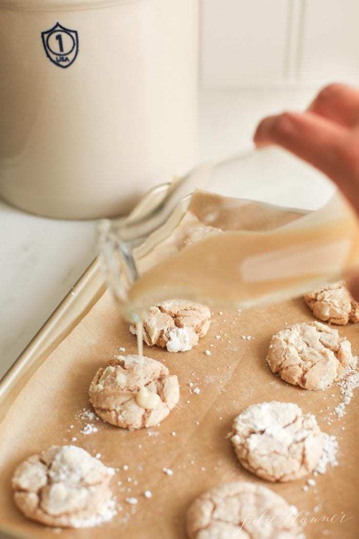 Glaze being poured over the cookies
