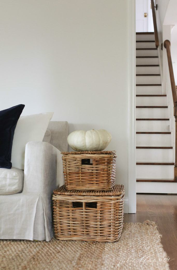 Heirloom pumpkins and wicker baskets are simple natural elements to bring into your fall living room decor