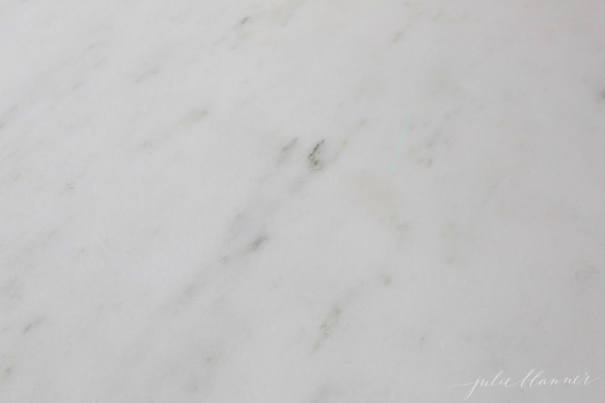 A close up of a marble countertop with an oil stain, after being sealed with DuPont StoneTech BulletProof Sealer.