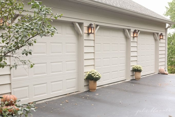 Mums in planters in front of garage is a natural way to add fall to your curb appeal