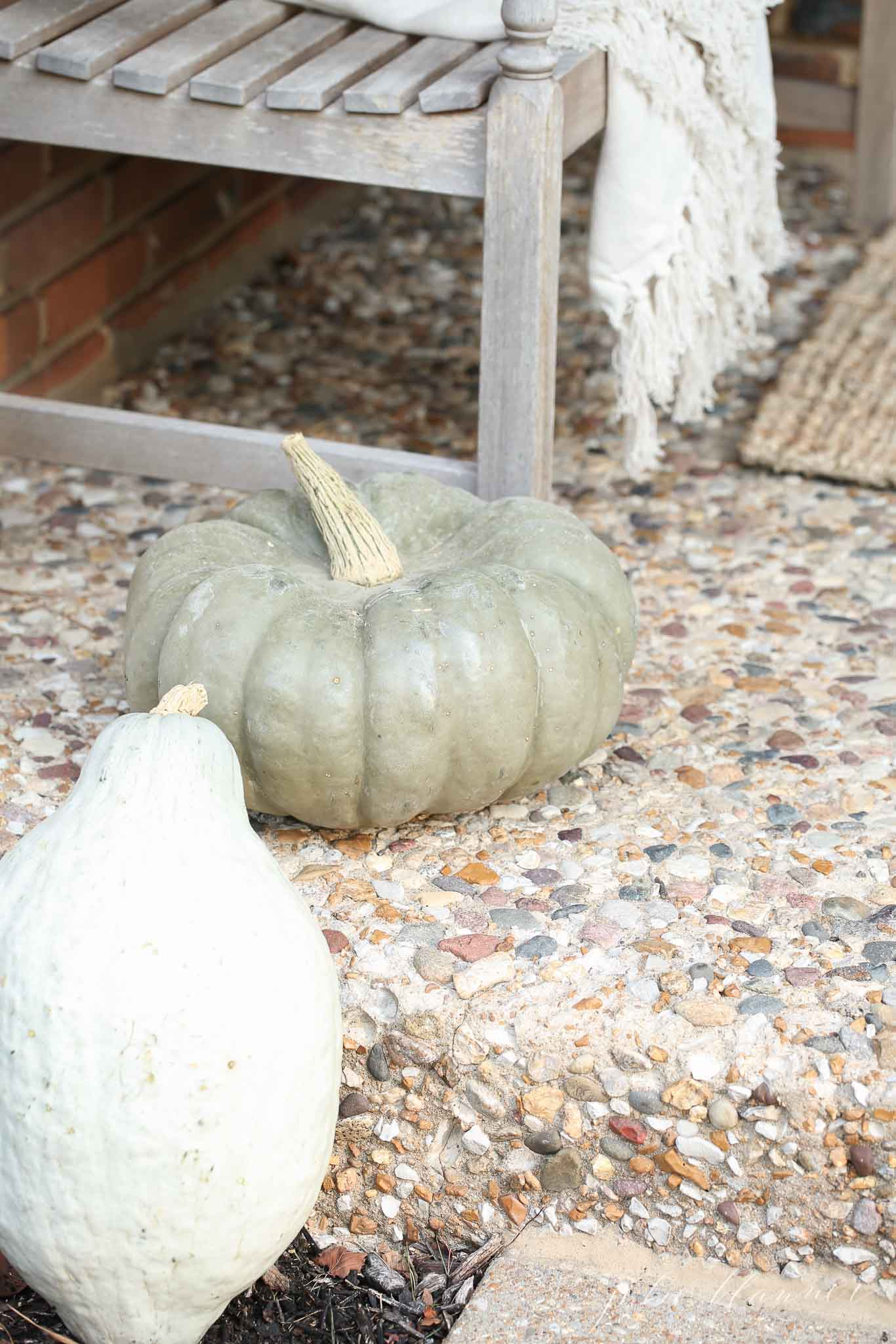 Heirloom pumpkin and squash are traditional fall porch decor staples