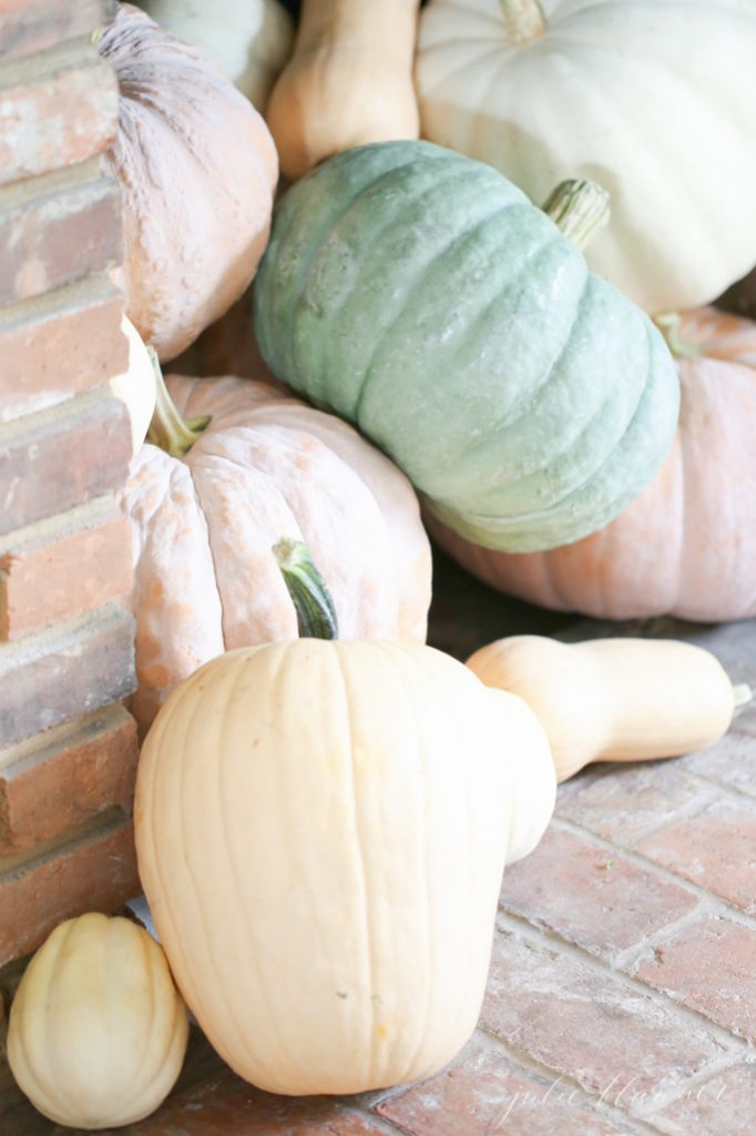 heirloom pumpkins spilling out of a fireplace