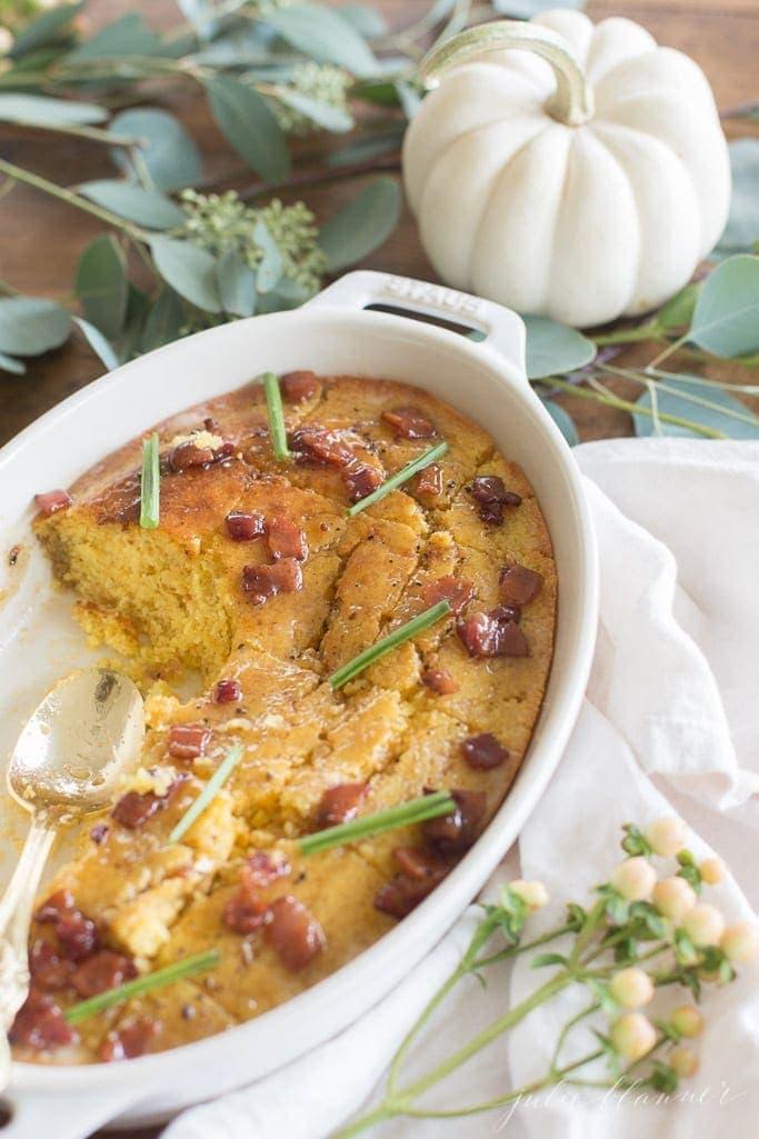 Cornbread in a casserole dish with a spoon
