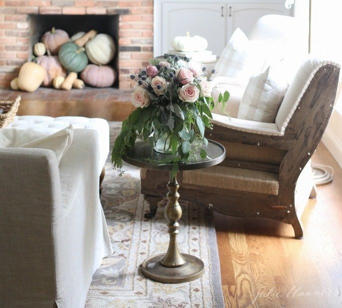 pastel fall decorating ideas with pumpkins in fireplace