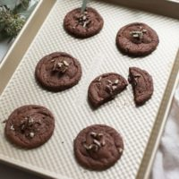 chewy chocolate mint cookies with andes candy on baking sheet