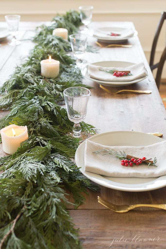 Red And Green Garland Centerpiece And Christmas Table Setting