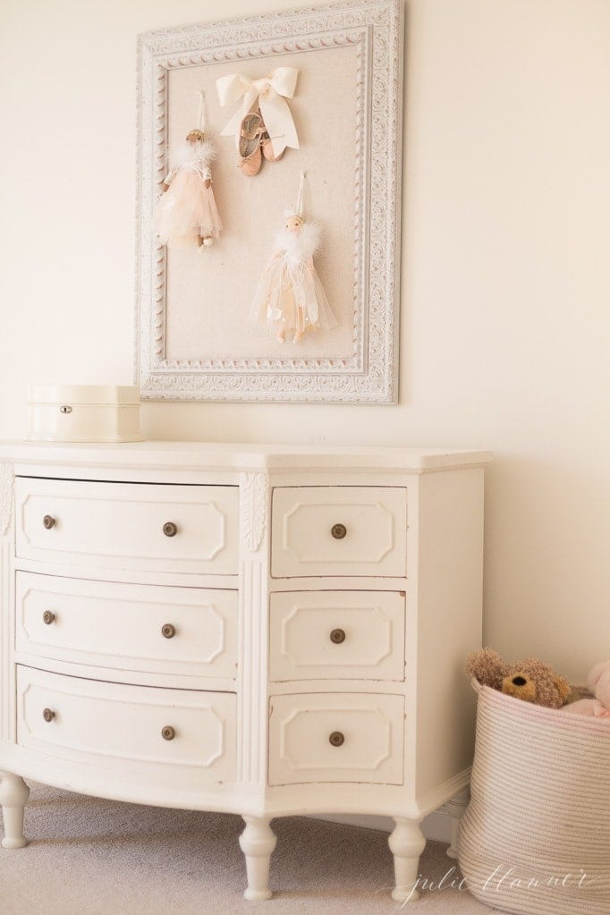 girls bedroom with a beige pin board inspired by the nutcracker sugar plum fairy