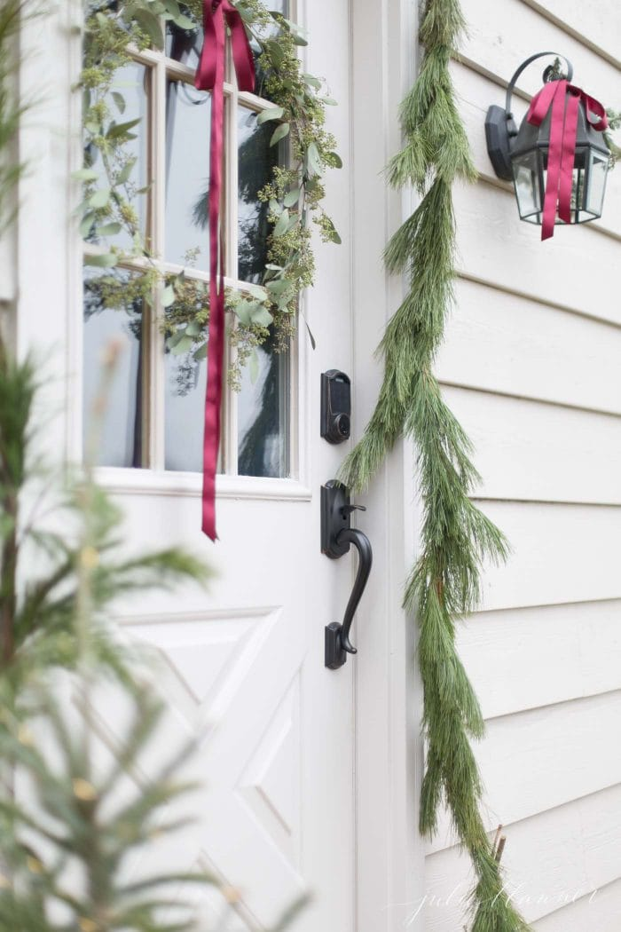 pine garland and red ribbon