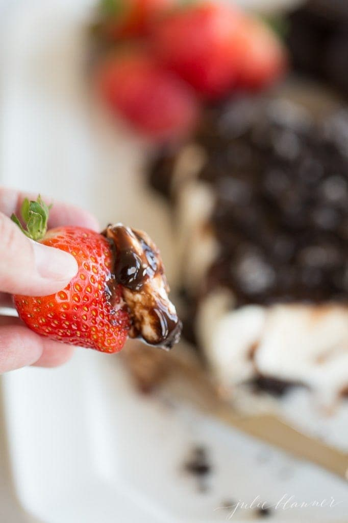cookies and cream cheese spread on a strawberry