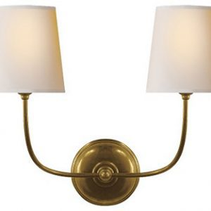raw brass sconce with off white shades
