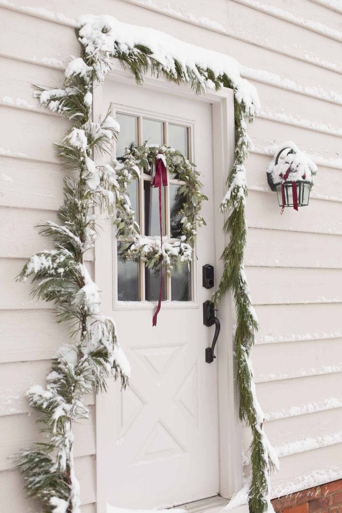 christmas door decorations covered in snow