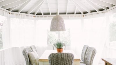 outdoor dining room furniture and screened in porch