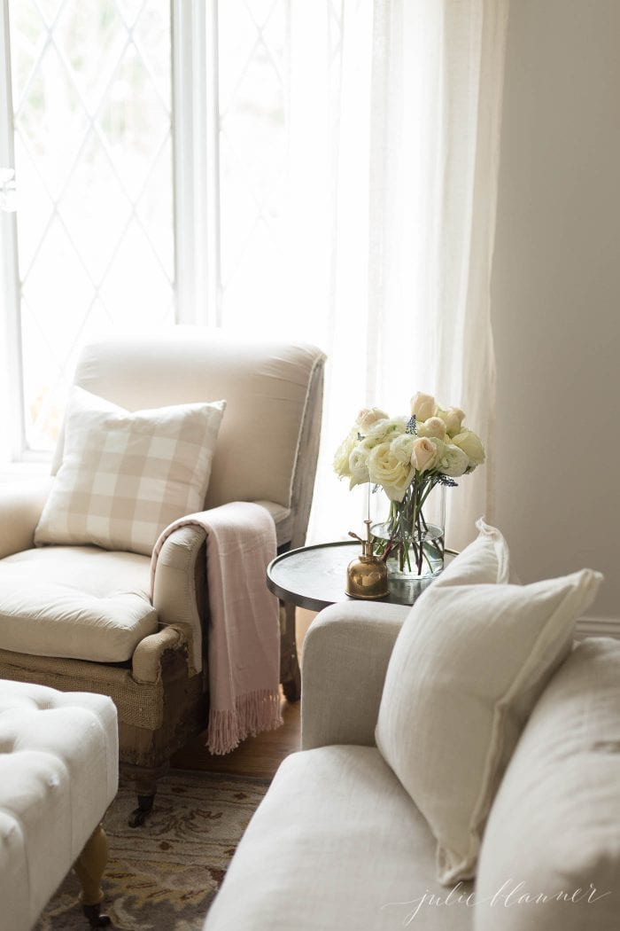 make a home feel warm by adding comforts like pillows and throws