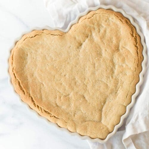 peanut butter cookie cake in heart shaped dish
