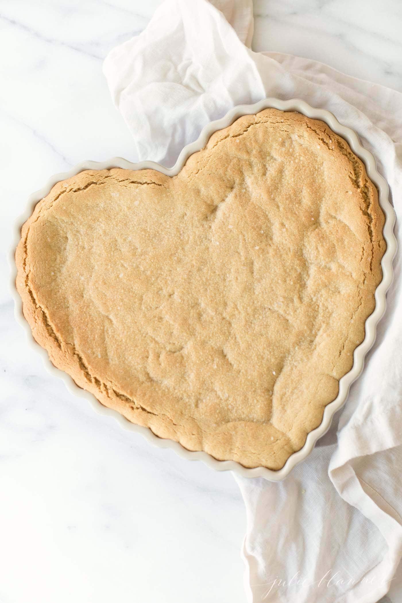 peanut butter cookie cake dessert in heart dish