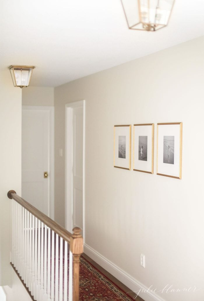 make a home feel warm and cozy by hanging pictures at eye level