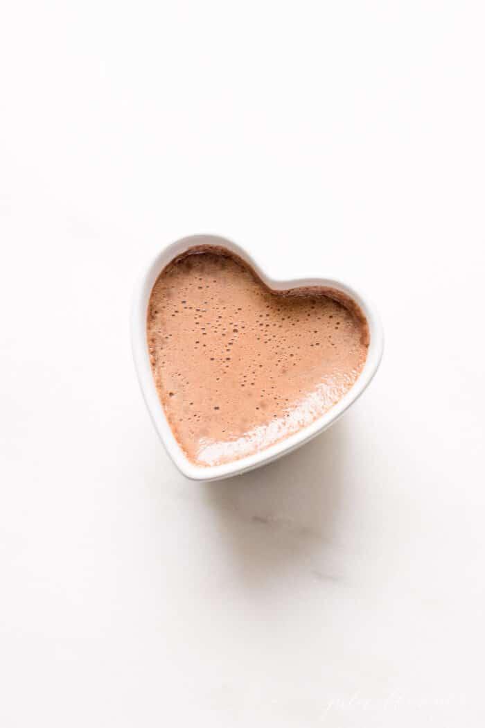 chocolate pots de crème in white ramekin on marble surface