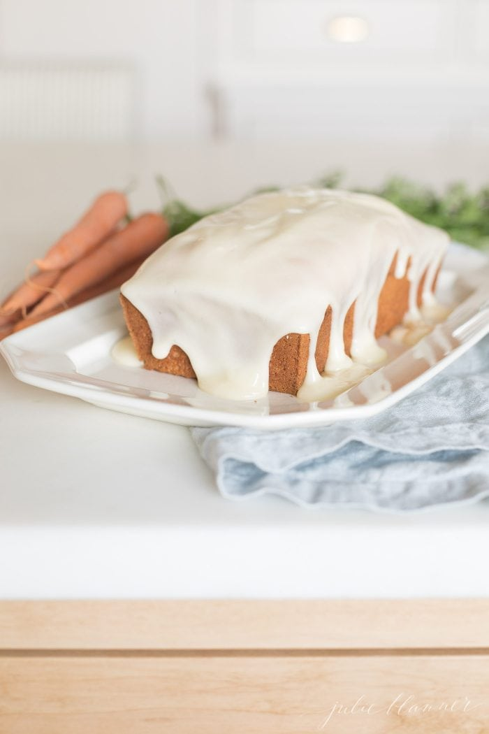 carrot cake loaf covered in glaze