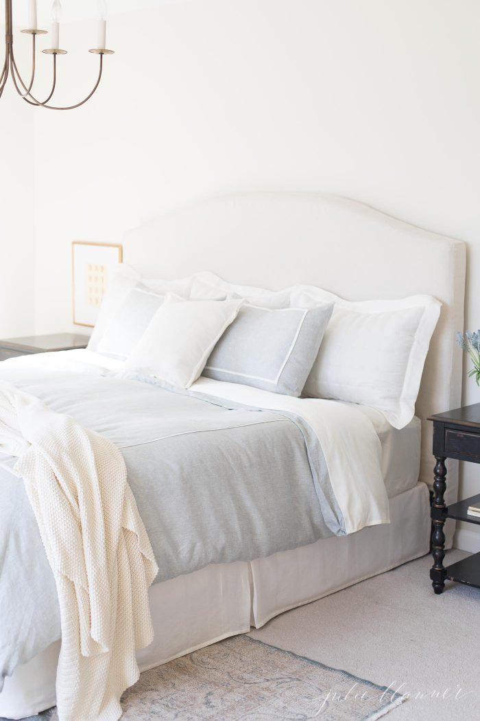 cream bedroom blue bedding brass light