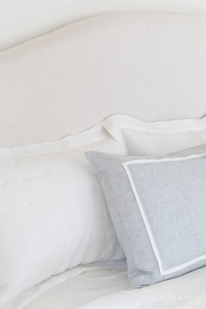 linen headboard and linen bedding