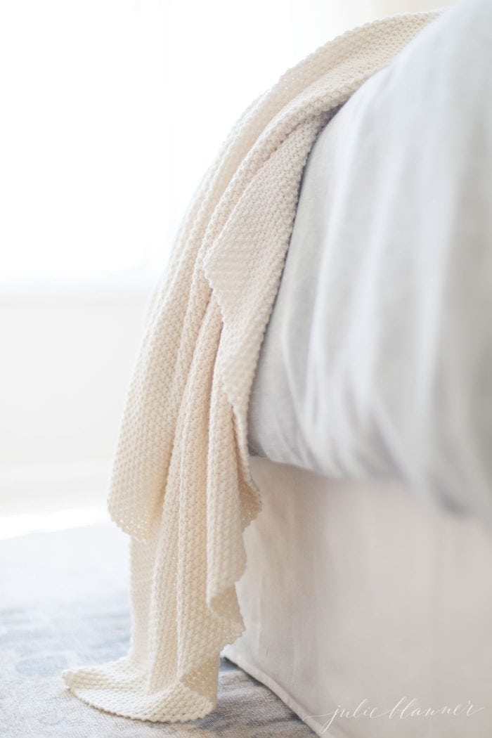 linen bedding with quilt draping off