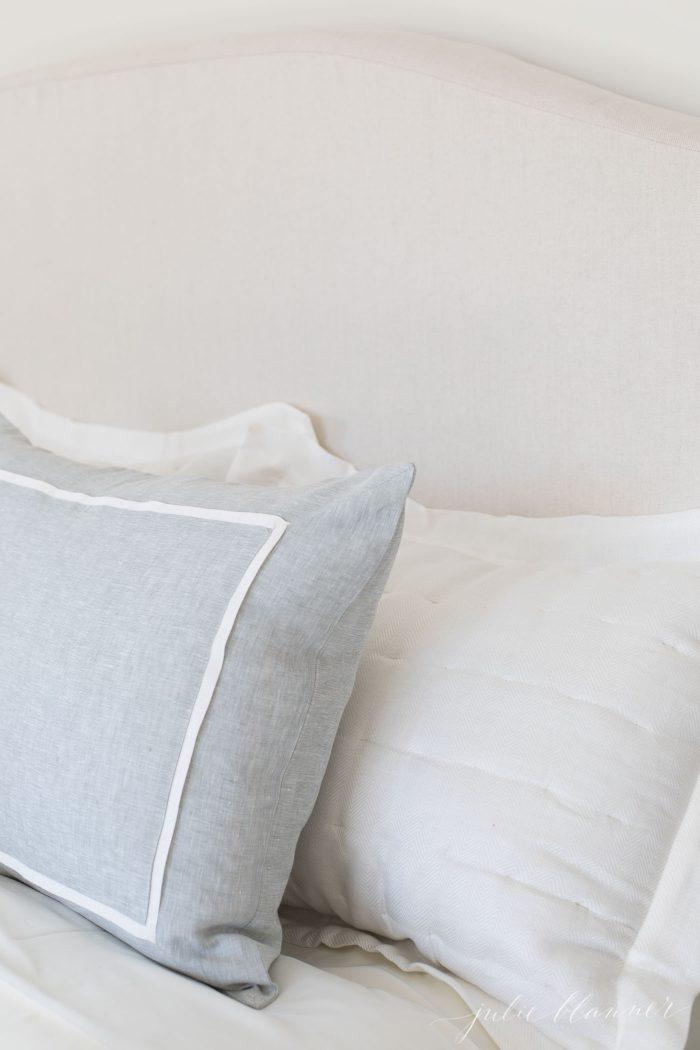 linen headboard with linen bedding