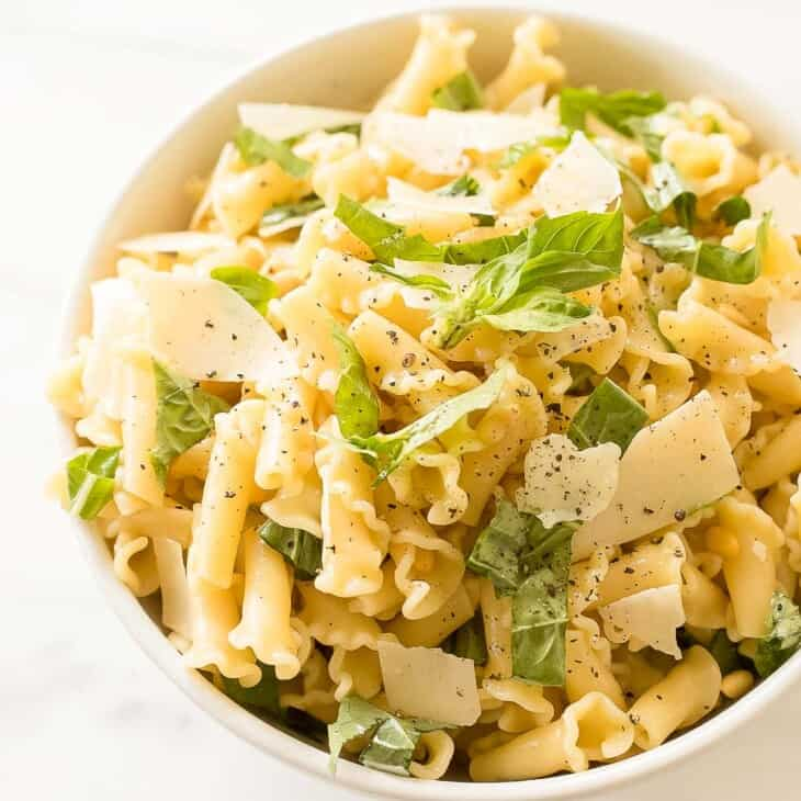 basil lemon pasta salad in white bowl