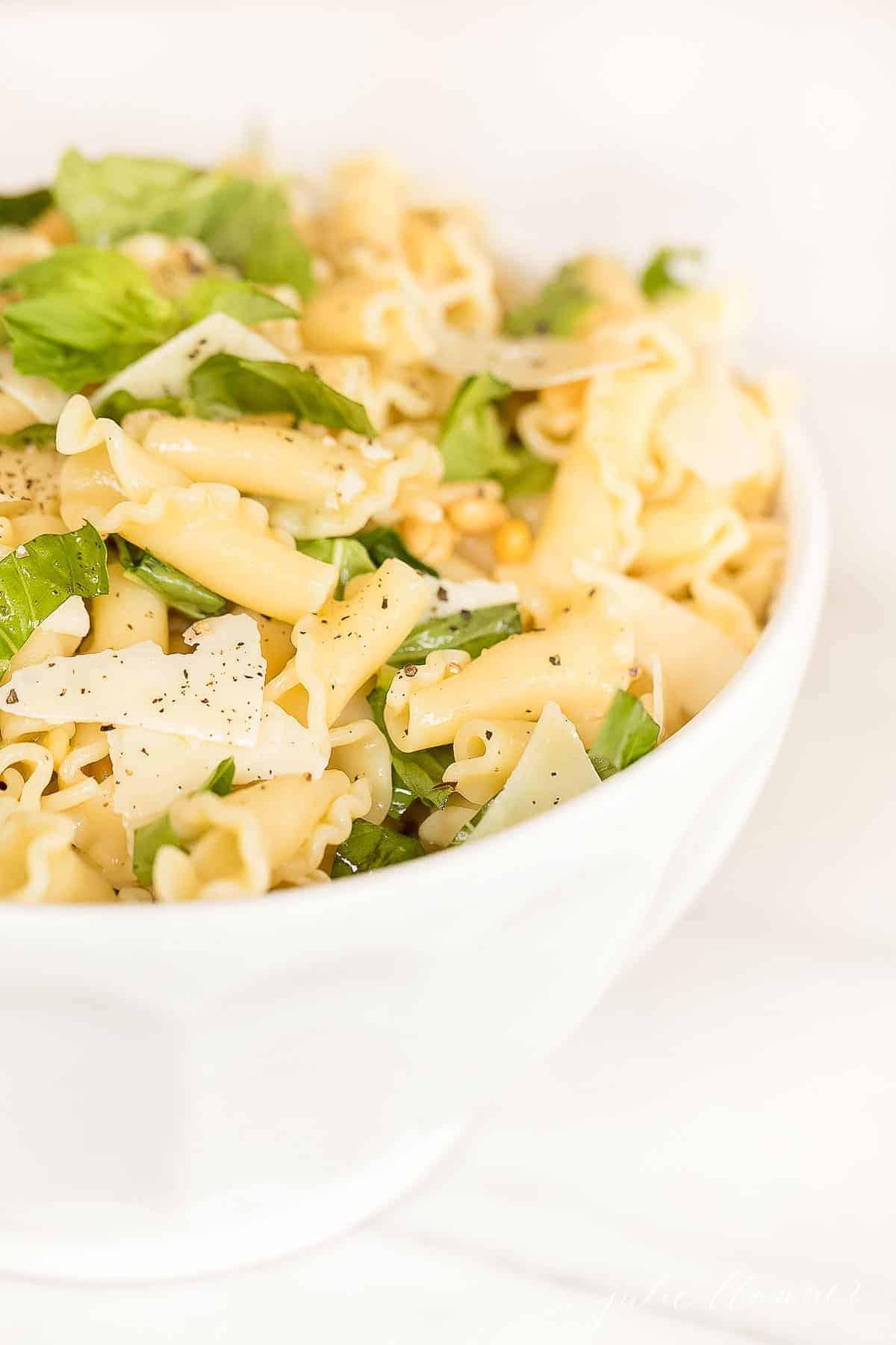 lemon basil pasta salad in white bowl