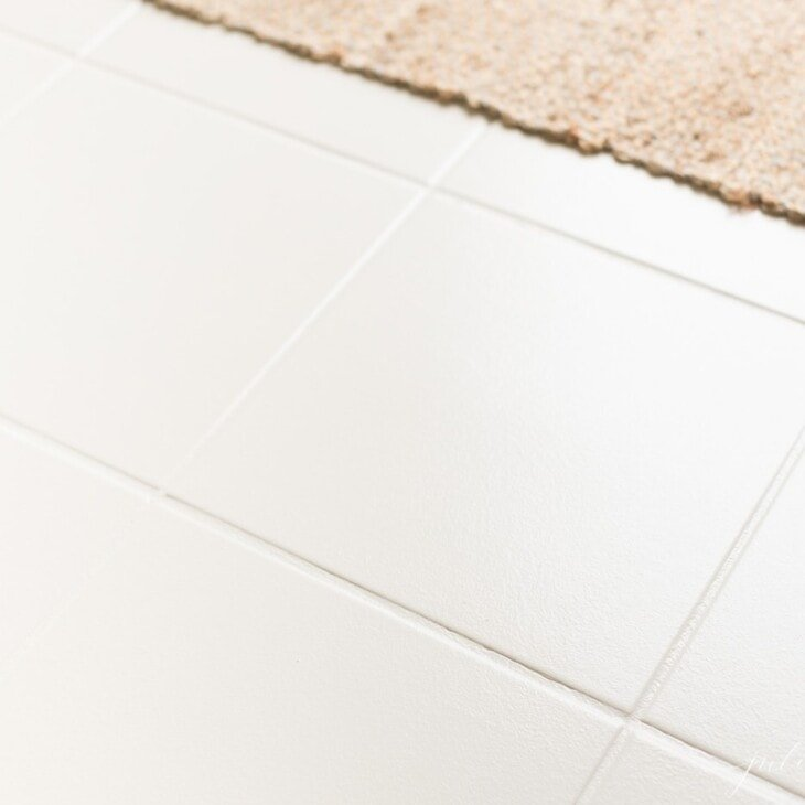 painted tile with neutral jute rug