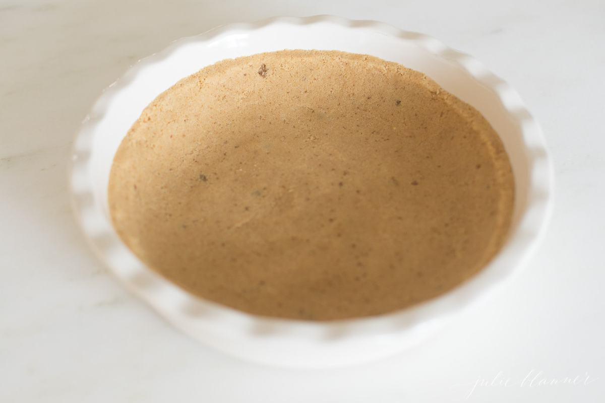 shortbread pie crust pressed into white dish