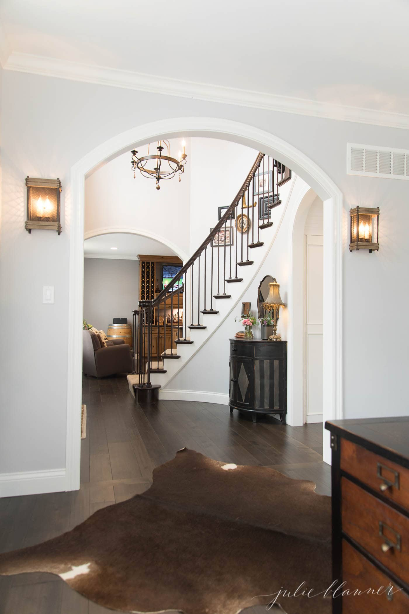 modern colonial staircase and arched opening