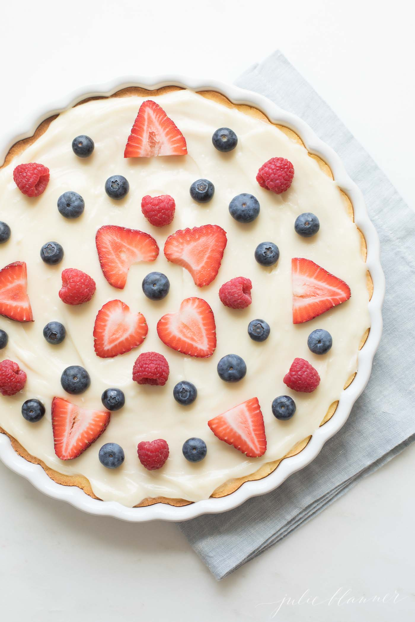 pretty fruit pizza with strawberries raspberries and blueberries