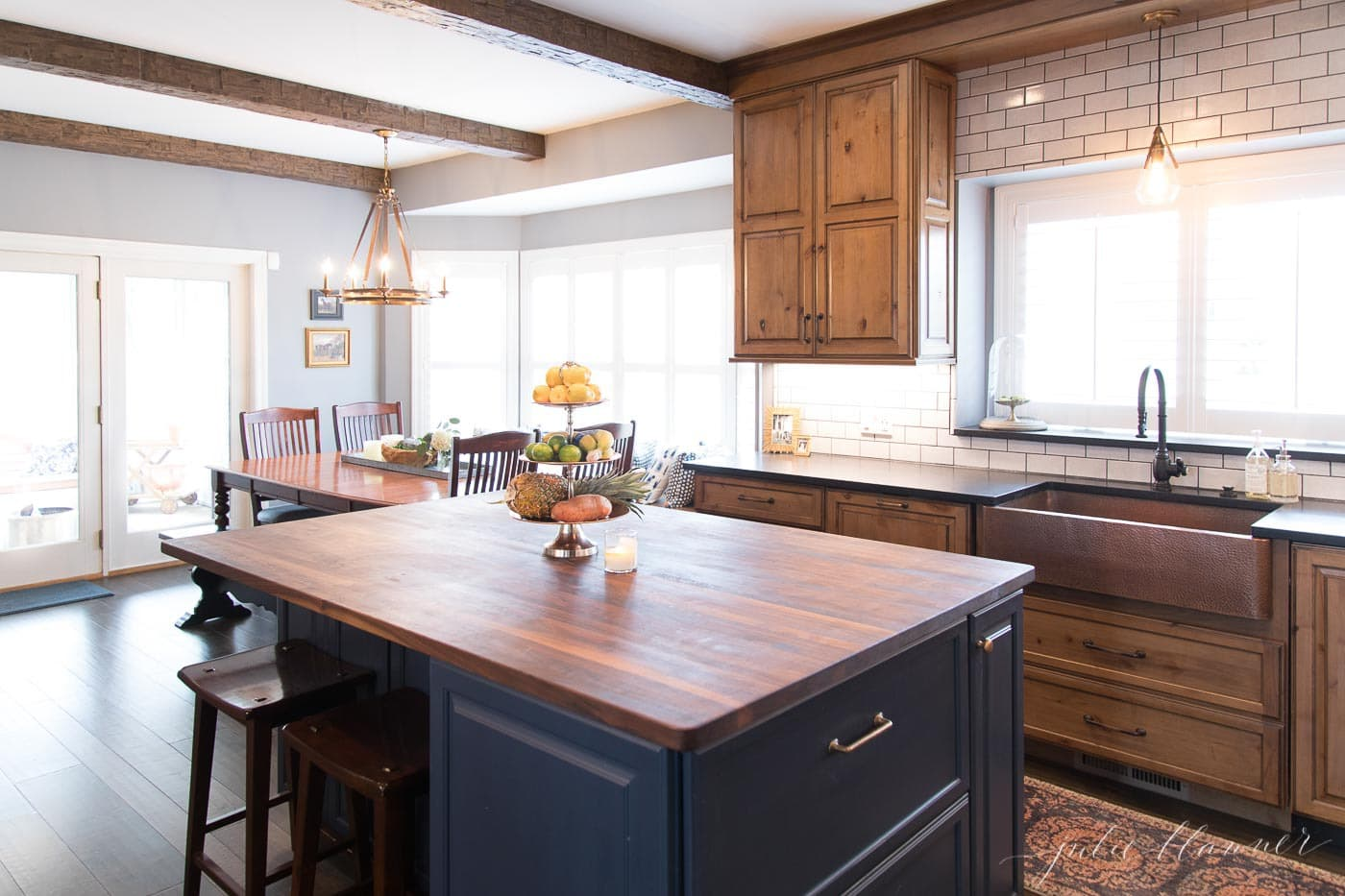 navy blue island and wood cabinets