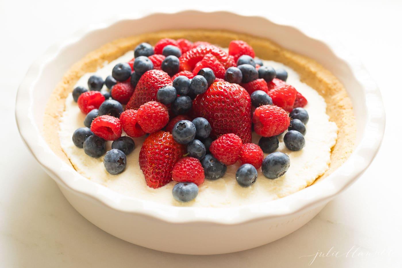 fruit pie in white pie dish