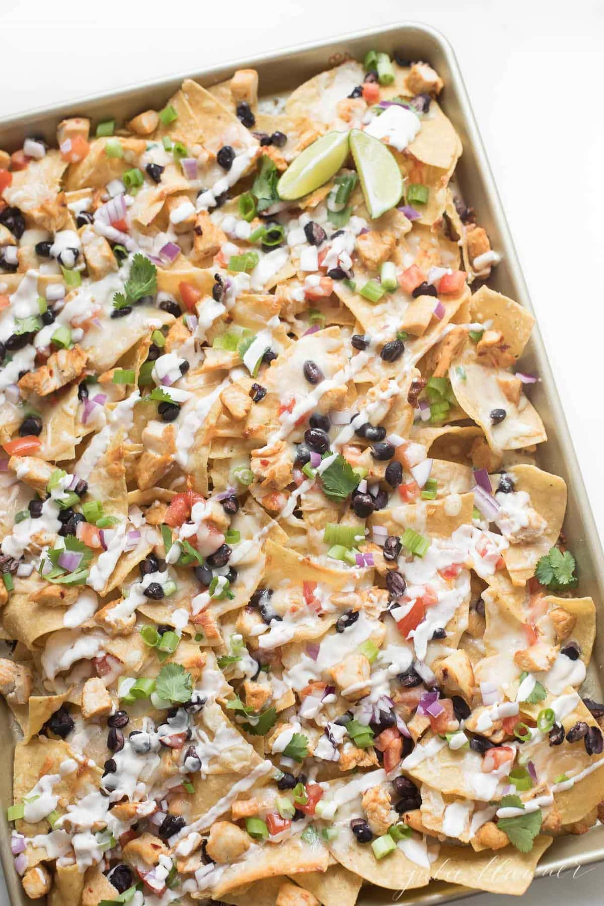 Easy chicken nachos in a sheet pan ready to serve