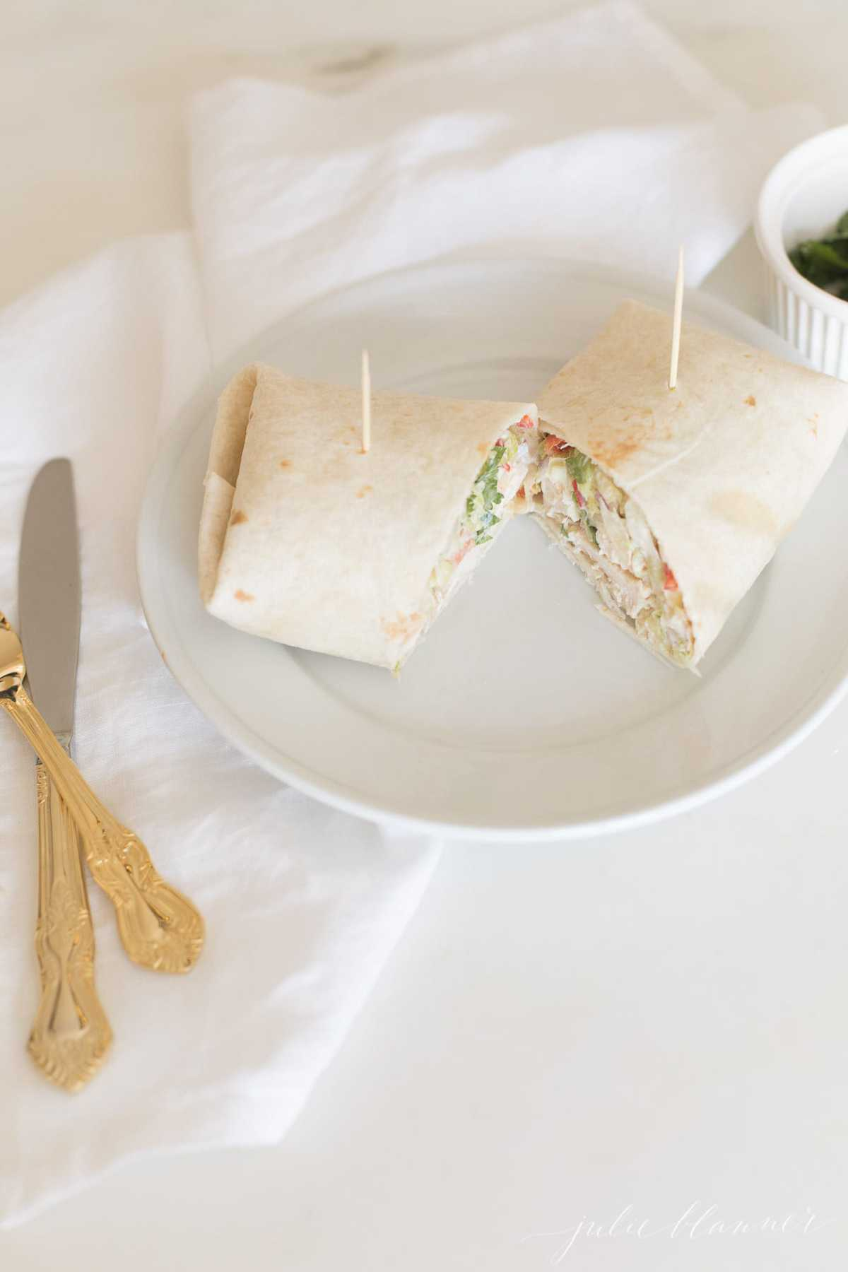 warp on a plate with napkin and utensils