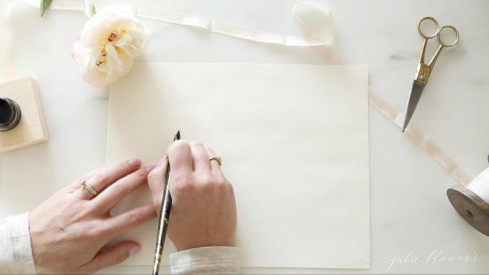 how to write calligraphy holding the pen