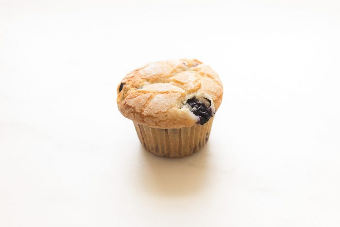blueberry muffin in cupcake liner