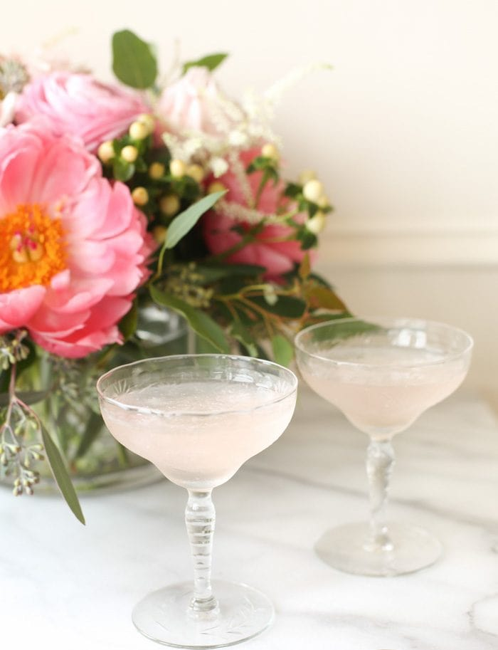 two glasses of frose by flowers