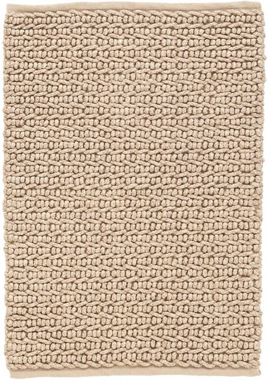 A pet friendly rug made of Polyester and Polypropylene that looks like a soft jute.