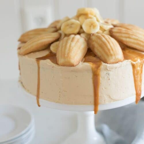 A banana cake topped with caramel frosting.